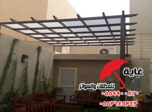 مظلات جلوس حديد خشابي مع إمكانية عمل إضافة من المقاعد الخشبية